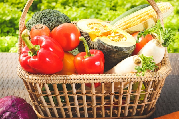 Variety of organic vegetables in wooden baskets