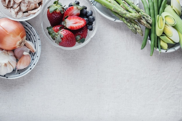 Variety of prebiotic foods, raw green banana, asparagus, onions, garlic, leeks