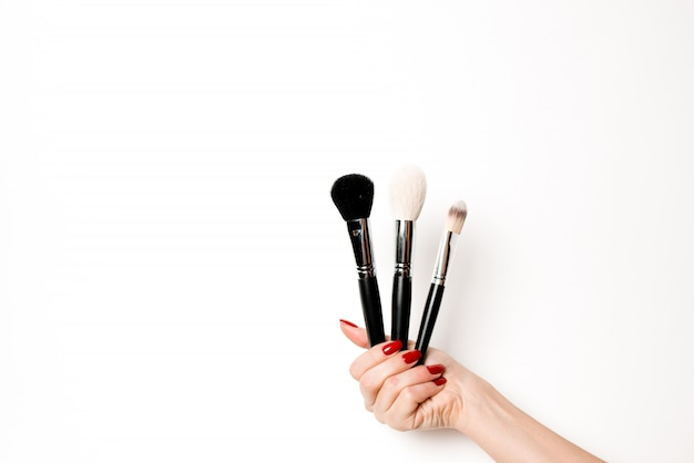 A variety of salon and makeup objects on an isolated white