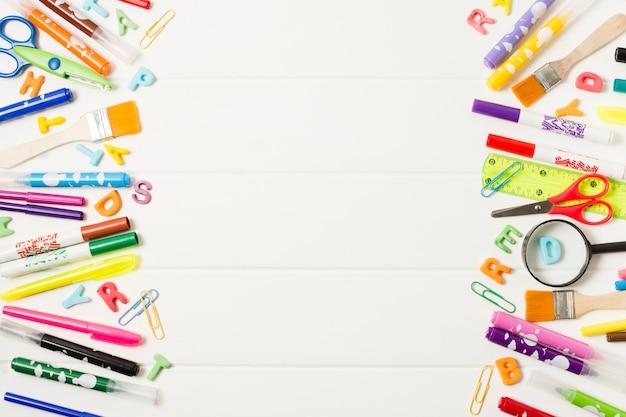 Variety of school supplies frame