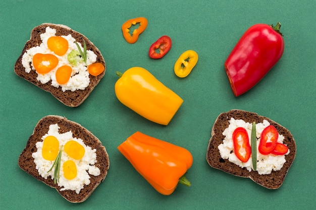 Variety of small sandwiches with various toppings. colored pepper.