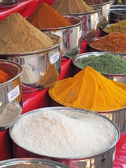 Variety of spices are in blue bowls for sale. heritage of india