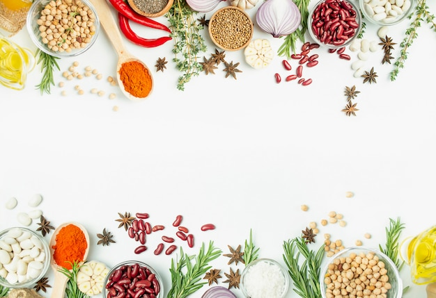 A variety of spices and herbs on a light table. cooking table. view from above. ingredients for cooking. table table menu.