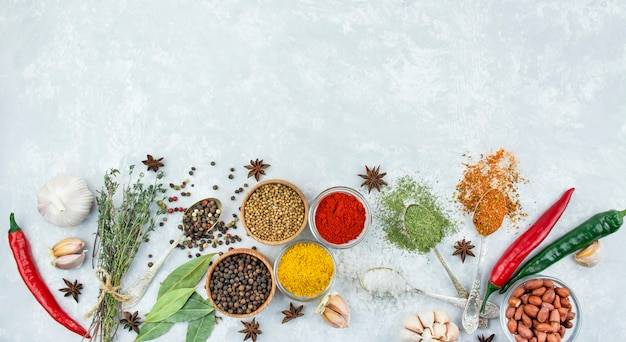 Variety of spices and herbs on a light table