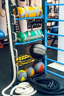 Variety of sport balls and equipment on gym background. fitness concept.