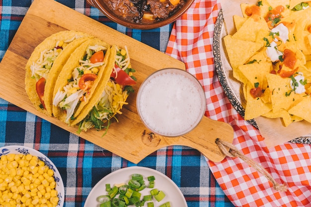 Variety of tasty delicious mexican dishes on table cloth
