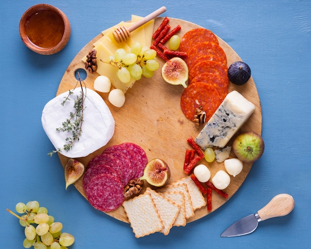 Variety of tasty snacks on a wooden board