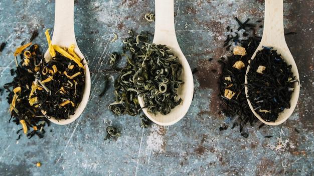 Variety of tea herbs in spoons flat lay