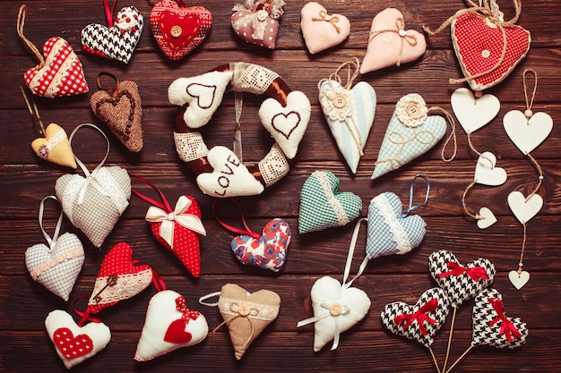 Variety of textile and wooden hearts on the holiday market. valentine day