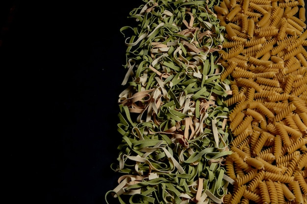 Variety of types and shapes of dry italian pasta. italian macaroni raw food background or texture:pasta, spaghetti , pasta in shape of spiral.