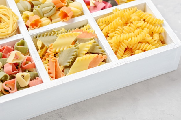 Variety of types and shapes of raw italian pasta.