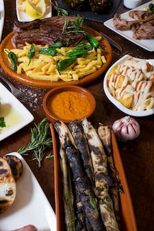 Variety of typical spanish dishes on wooden table