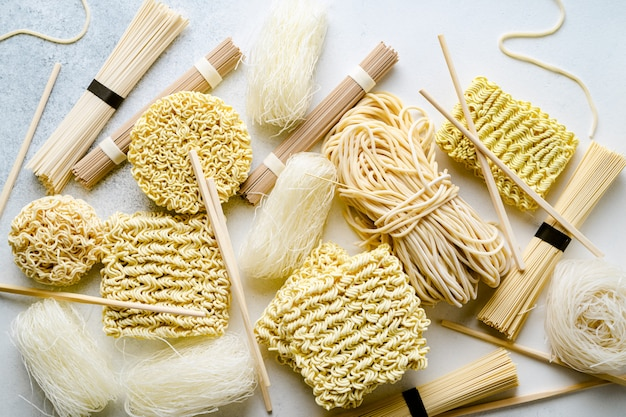 Variety of uncooked asian noodles