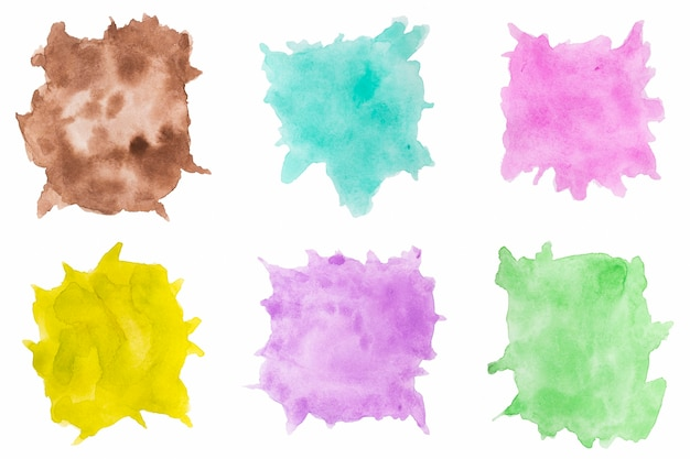 Variety of watercolour splashes on white backdrop