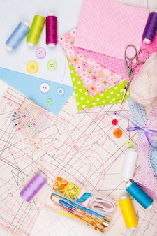 Various accessories for sewing, needlework. scissors, threads, needles, pins, fabric, pattern, button, lace