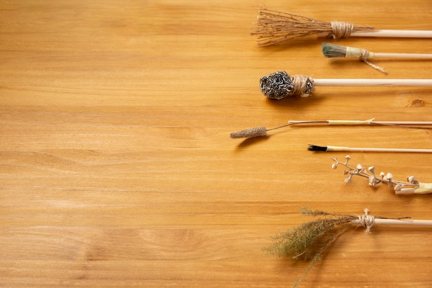 Various alternative paint brushes on wooden background