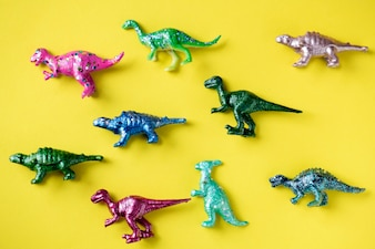 Various animal toy figures in a colorful background