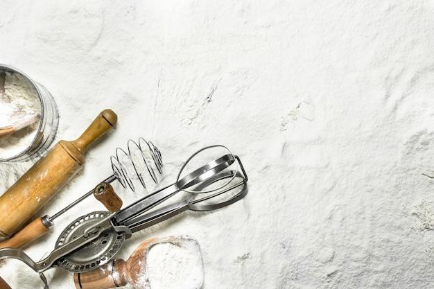 Various baking tools on flour.