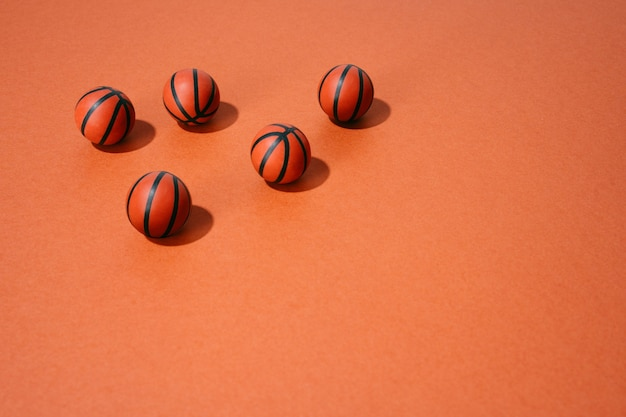 Various basketballs on red background. sport and competition.copy space. 3d illustration