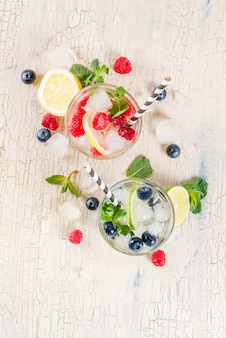 Various berry lemonades with trays