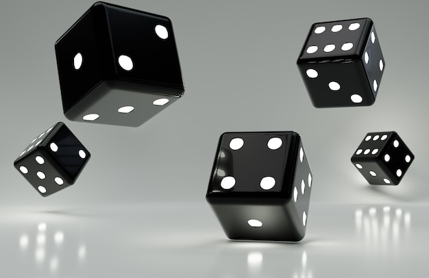 Various black dice on glossy gray surface