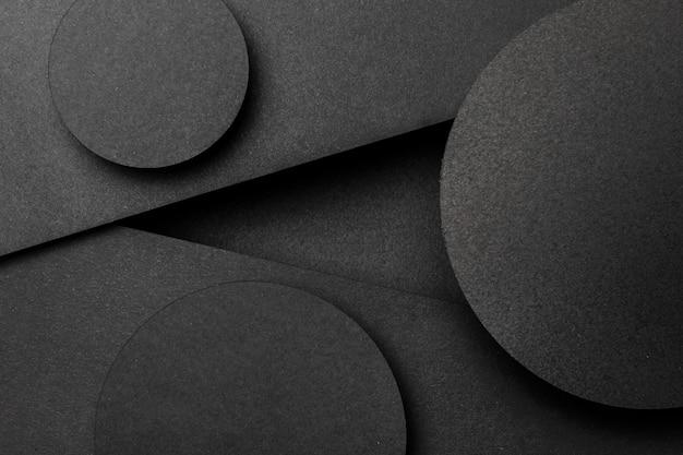 さまざまな黒い三角形と円の背景