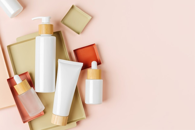 Various blank cosmetic container mock-ups on pastel color backgroun