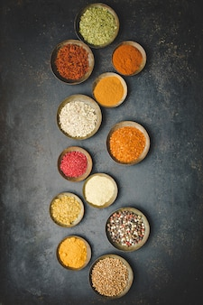 Various bowls of spices top view