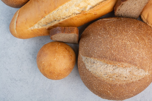 Various bread and buns on marble background. high quality photo