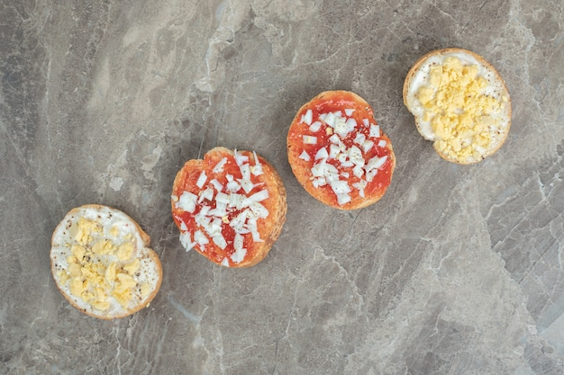 Various bruschetta on wooden plate with eggs. high quality photo