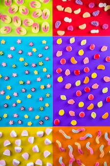 Various candies on multicolored background