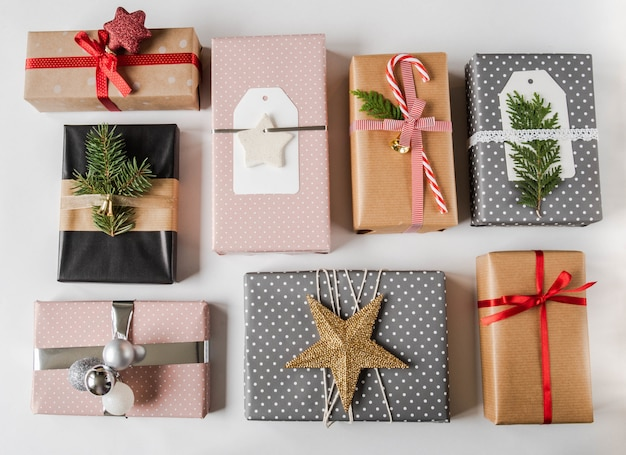 Various christmas gift boxes. collection of christmas or new year gift boxes and decoration on white background. gift wrapping decor ideas.