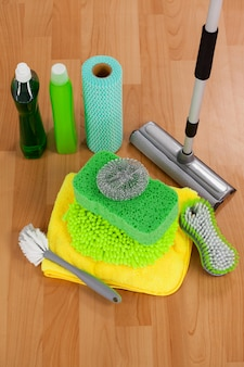 Various cleaning equipment on wooden floor