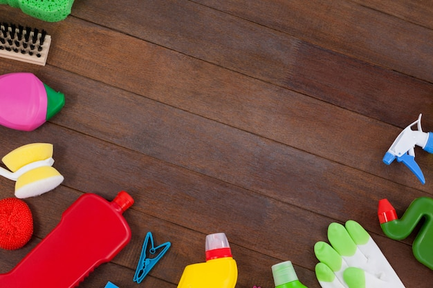 Various cleaning equipments arranged on wooden floor