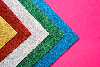 Various colorful carpets on pink background