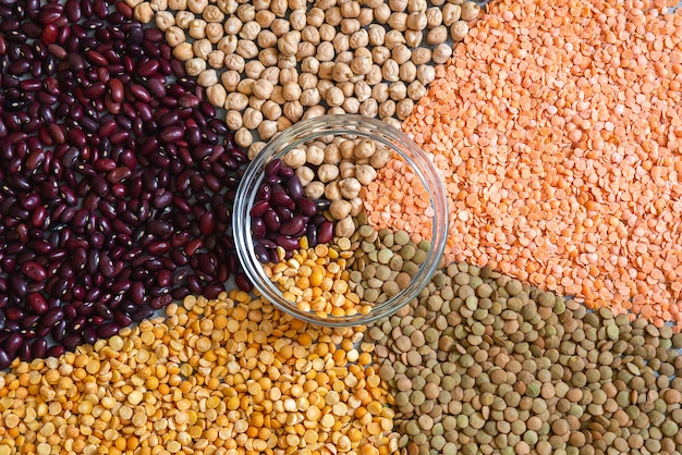 Various colorful dried legumes beans for background