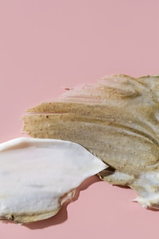 Various cosmetic mask, creams, serum, scrub and lotion smear on a pink background. beauty texture. sample of a cosmetic product.
