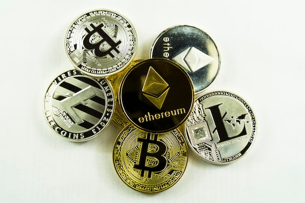 Various crypto-currents bitcoin, lightcoin, ethereum on a white background