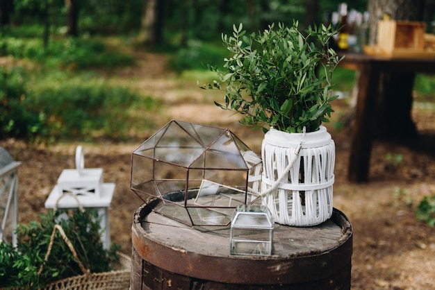 Various decor items at a wedding venue decorated for a stylish boho wedding