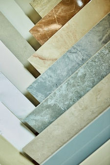 Various decorative tiles samples. colorful samples of a stone tile in store