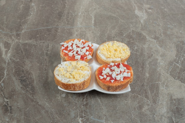 Various delicious bruschetta on white plate. high quality photo