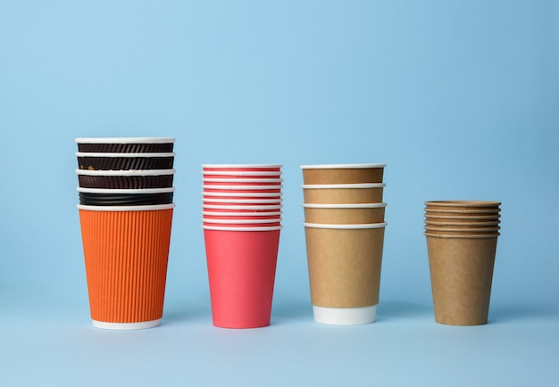 Various disposable paper cup on blue background, rejection of plastic, zero waste