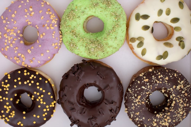 Various donuts lying in box