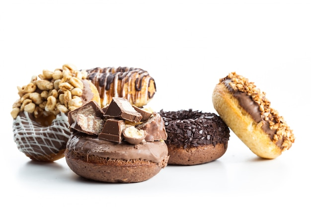 Various donuts on white surface