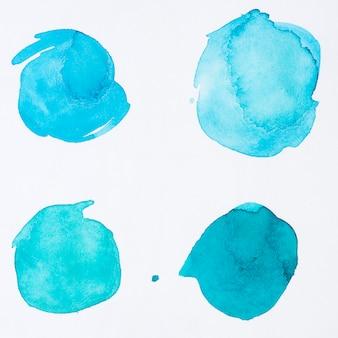青い水彩絵の具のさまざまなドット