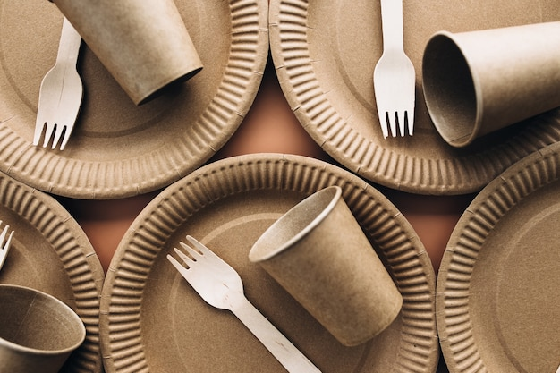 Various eco-friendly kraft paper packaging, fork, cup and plate, containers for takeaway food. zero waste and recycling concept. high quality photo