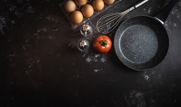 Various food ingredients on a dark background with a space for text or message