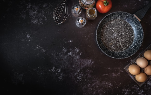 Various food ingredients on a dark background with a space for text or message Premium Photo