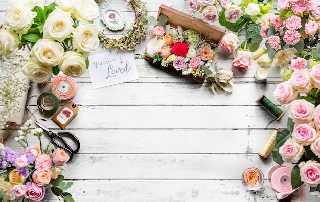 Various fresh flowers on wooden background design space