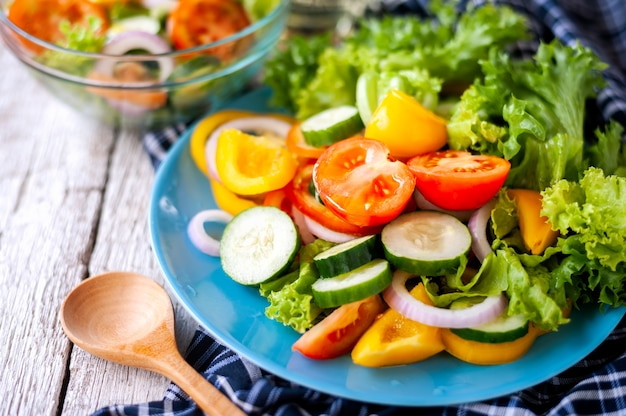 Various fresh mix salad with tomato, cucumber, onion, bell pepper, healthy food and diet m